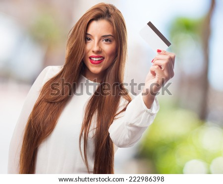 a young woman shopping with her credit card - stock photo