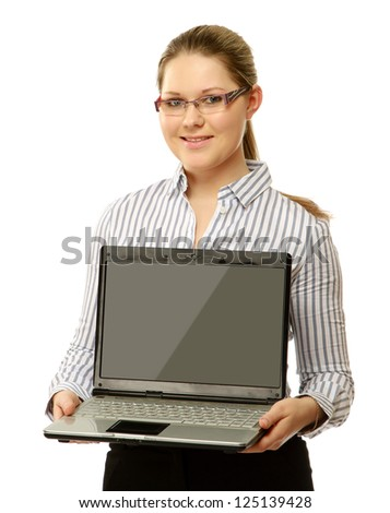 A young woman showing a laptop, isolated on white