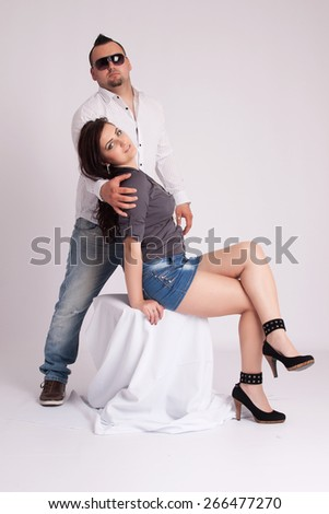 A young woman sits and rests on a young man - stock photo