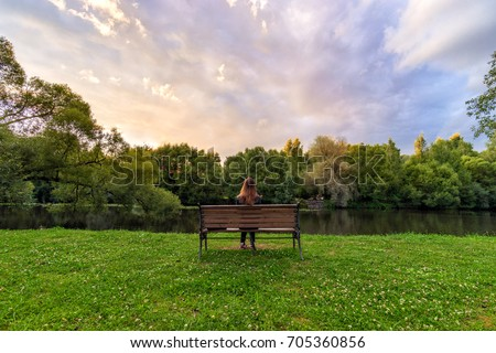stock-photo-a-young-woman-sitting-alone-