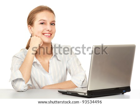A young woman sitting in front of a laptop, isolated on white background