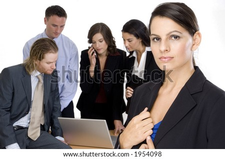 A young woman standing in front of her business team