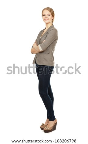 A young woman standing in full length isolated on white background .