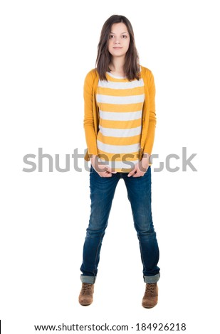 A young woman standing in jeans and a T-shirt. Isolated over white - stock photo