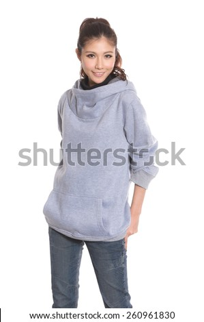 A young woman standing in jeans posing on white background