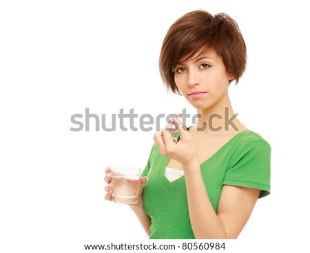 A young woman taking pills - stock photo