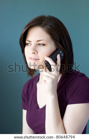 A young woman talking on the phone. - stock photo