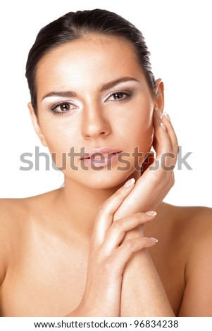 A young woman touching her face, closeup , isolated on white background