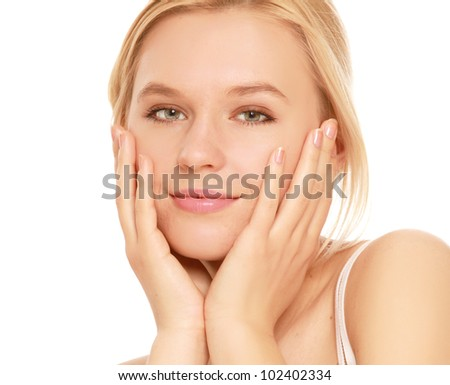 A young woman touching her face , isolated on white background - stock photo