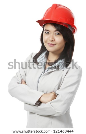 A young woman wearing a hardhat (on white). - stock photo