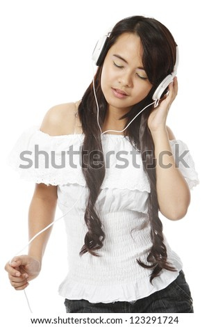 A young woman wearing headphones on white background - stock photo