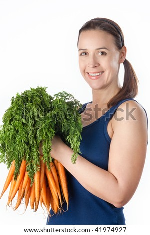 A young woman with a bunch of ripe carrots on a white background