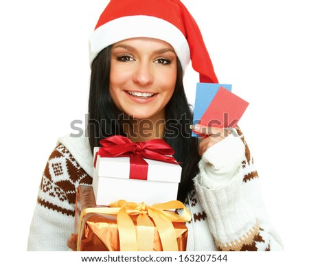 A young woman with a Christmas present and cards, isolated on white