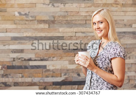 A young woman with a cup of coffee