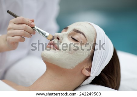 A young woman with a face pack.  - stock photo