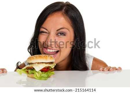 a young woman with a hamburger. fast food and quick meals - stock photo