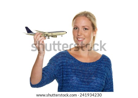 a young woman with a model of an airplane looking forward to your next holiday. - stock photo