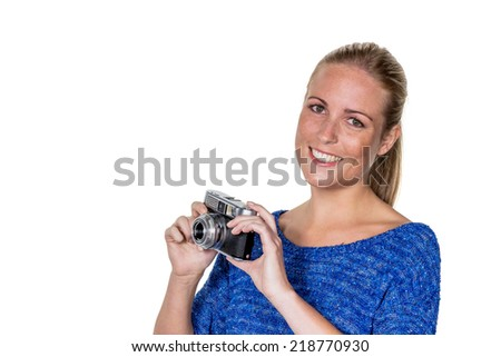 a young woman with an old camera. cameras in the retro look in again. - stock photo
