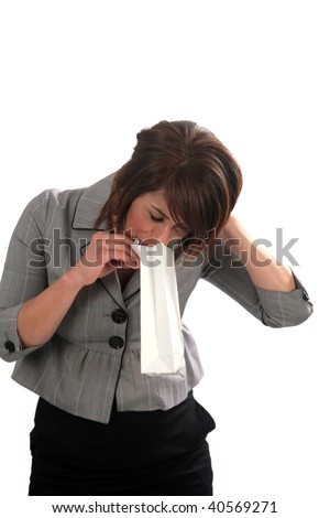 a young woman with an upset stomach, isolated on white - stock photo
