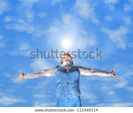 A young woman with arms stretched out to the sky