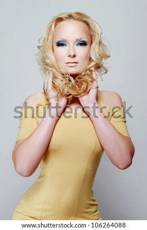 A young woman with bright make-up - stock photo