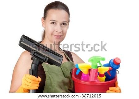 A young woman with cleaning equipment ready to clean - on white. - stock photo