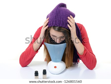 A young woman with colds and flu inhaled essential oils - stock photo