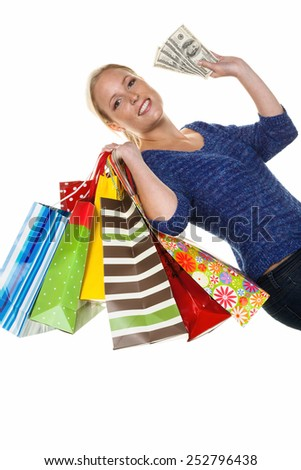 a young woman with colorful shopping bags while shopping. with dollar banknotes - stock photo