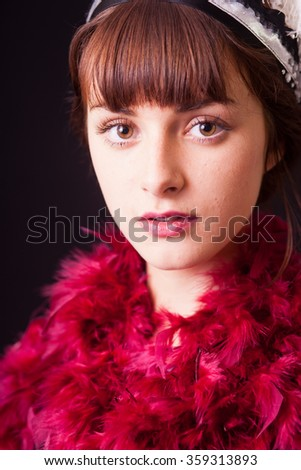a young woman with feather boa in 20s style