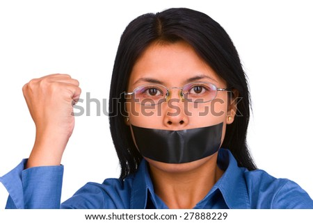 A young woman with her mouth plastered and her fist raised. - stock photo