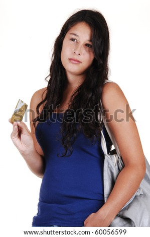 A young woman with long brunette hair, thinking to spend or not, with her credit card in her hand and a bag over her shoulder, for white background. - stock photo