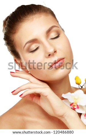 A young woman with orchid, isolated on white - stock photo