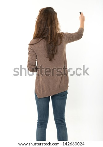 A young woman writing, on wall, blackboard, whatever you choose