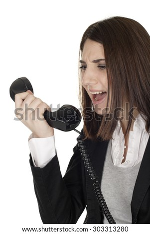 A young woman yelling into a telephone handset. - stock photo