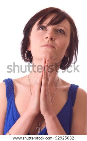 a young women praying isolated on a white background.
