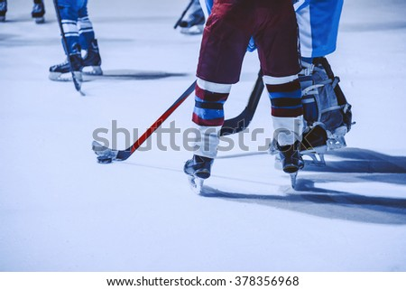 A youth hockey players on the ice. Young boys in hockey equipment - stock photo