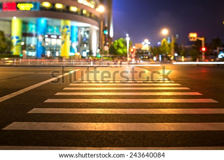 A zebra crossing on the streets of the city - stock photo