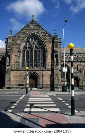 A zebra crossing to one of the several churches in St Andrews, Scotland. - stock photo