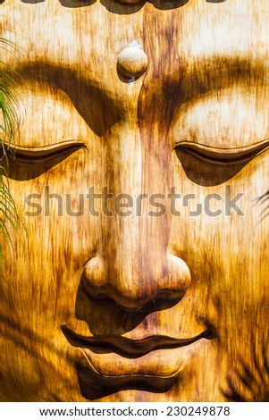 a zen wooden sculpture in an ancient oriental temple - stock photo