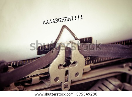 AAARGH! Frustration word typed on a Vintage Typewriter. - stock photo