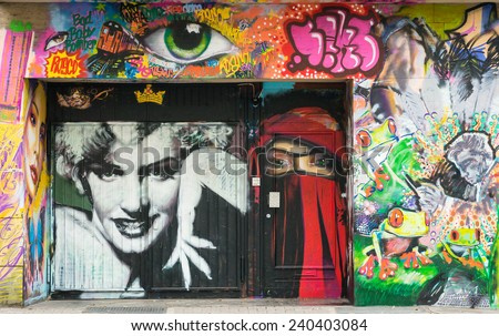 AACHEN, GERMANY - DECEMBER 6, 2014: A door covered by graffiti of Marilyn Monroe's portrait. Aachen is a city with population of 260,000 in North Rhine-Westphalia. - stock photo