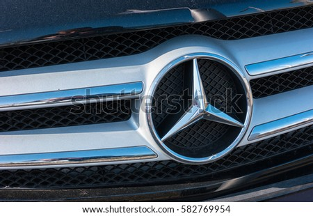 AACHEN, GERMANY FEBRUARY, 2017: Mercedes Benz logo close up on a car grill. Mercedes-Benz is a German automobile manufacturer. The brand is used for luxury automobiles, buses, coaches and trucks.
