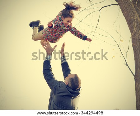 aaFather playing with daughter in the park - stock photo