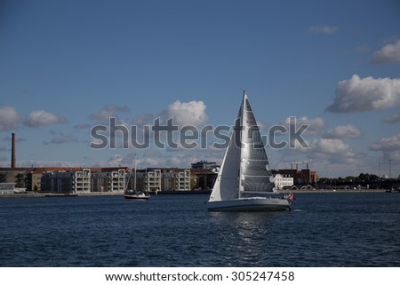 Aalborg, Denmark - September 21, 2014: Sailing boat on the Limfjord river on a beatiful autumn day.