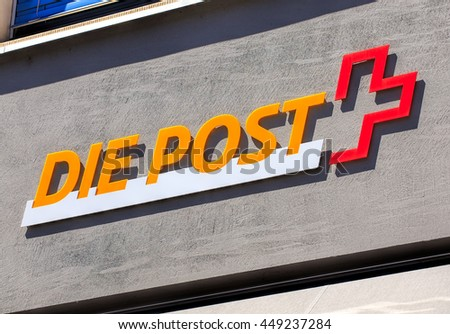 Aarau, Switzerland - 7 July, 2016: Swiss Post sign on the wall of a post office. Swiss Post a public company owned by the Swiss Confederation, which provides national postal service for Switzerland.