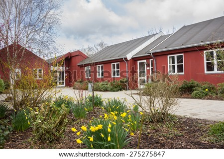 AARHUS, DENMARK - April 13, 2015: Classic red wooden school building in Jutland Denmark