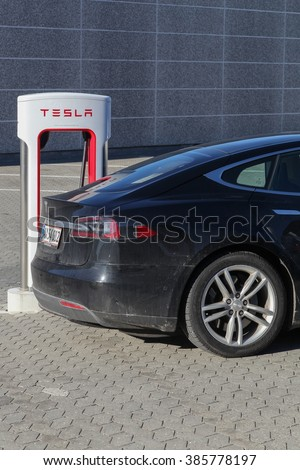 Aarhus, Denmark - February 13, 2016: Tesla supercharger station in Aarhus. Tesla is an American automotive and energy storage company that designs, manufactures and sells luxury electric cars