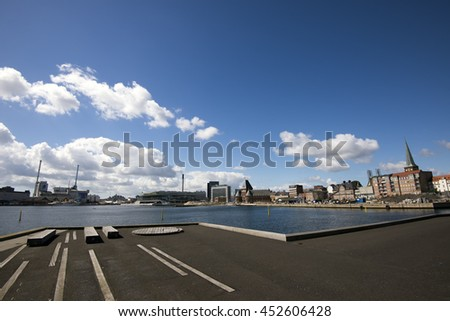 AARHUS, DENMARK - JULY 13, 2016: Aarhus harbor skyline - view from Aarhus new harbor area. Royal Yacht Dannebrog is docked to the left side. July 13, 2016 - stock photo