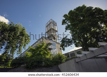 AARHUS, DENMARK - JULY 13, 2016: View on City Hall of Aarhus with the clock tower and tree around. July 13, 2016. - stock photo
