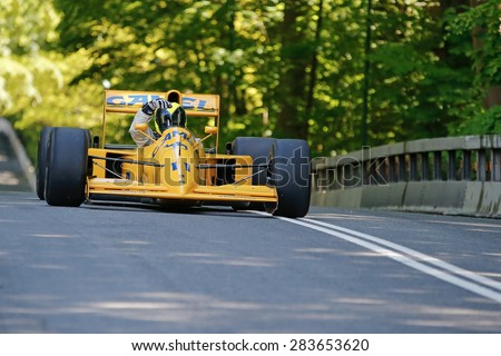 AARHUS, DENMARK - MAY 22 2015: Andrew Morris in a Camel Lotus with a Lamborghini engine formula one racing car at the Classic Race Aarhus 2015 - stock photo